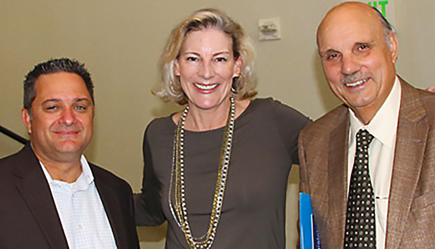 Mike Kirst, right, poses with ACSA Executive Director Wes Smith and former Senior Director of Governmental Relations Karen Stapf Walters in 2015 when Kirst received his ACSA Friend of Education Award.